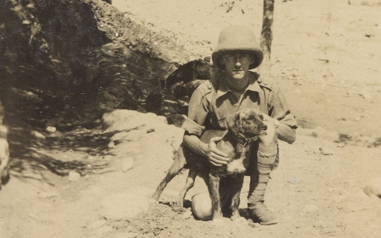 Captain Charles Mosse, 120th Rajputana Infantry, with his dog in Waziristan, 1920