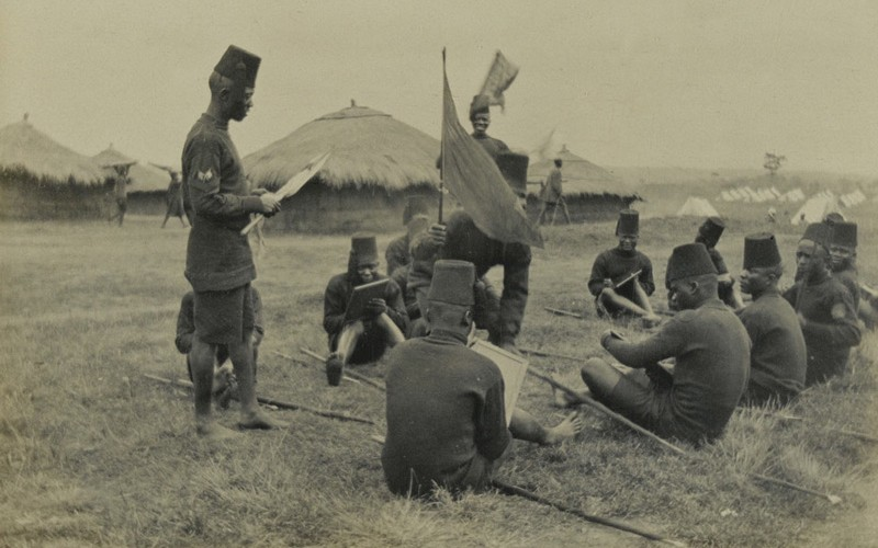 Soldiers of the King's African Rifles undergo instruction in the use of signalling flags, 1916