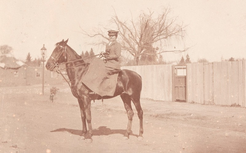 A member of the First Aid Nursing Yeomanry on horseback, c1910