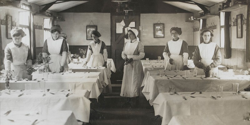 Women's Army Auxiliary Corps waitresses setting tables in an officers' mess, c1917