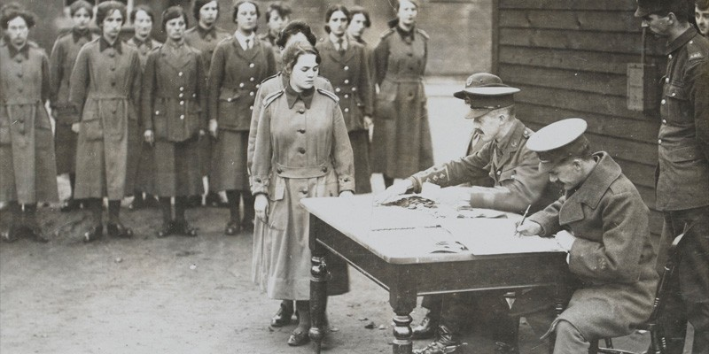 Women's Army Auxiliary Corps personnel line up for their pay, c1917
