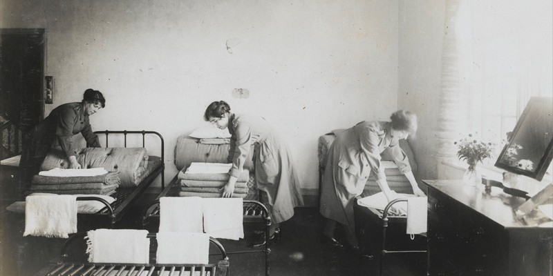 Women's Army Auxiliary Corps personnel making their beds in billets, c1917