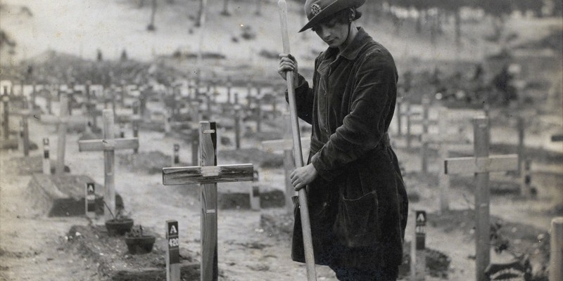 A member of the Women's Army Auxiliary Corps in a graveyard at Étaples, France, 1918