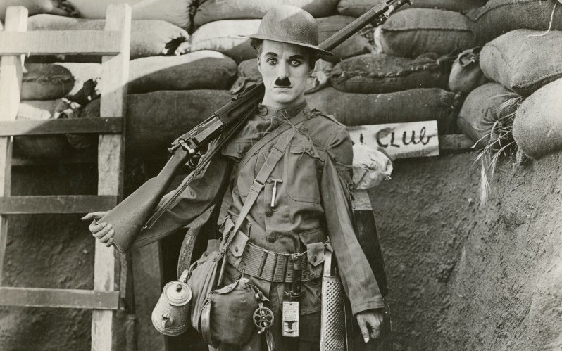Charlie Chaplin in a promotional photograph for 'Shoulder Arms', 1918