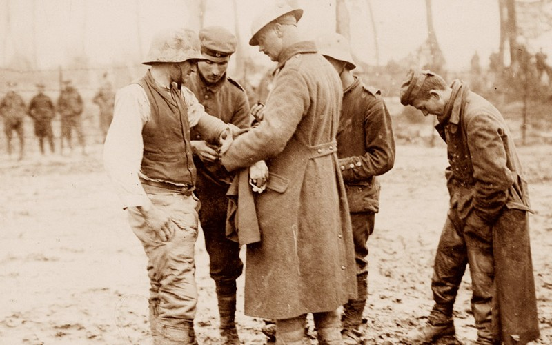 Treating a wounded German prisoner near Langemarck, 26 September 1917