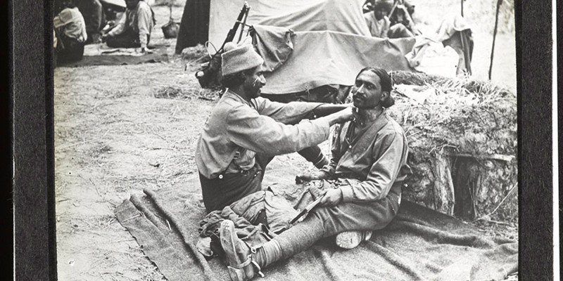 An Indian barber goes to work at the Indian Cavalry camp near Querrieu, located on the Albert-Amiens road, 29 July 1916