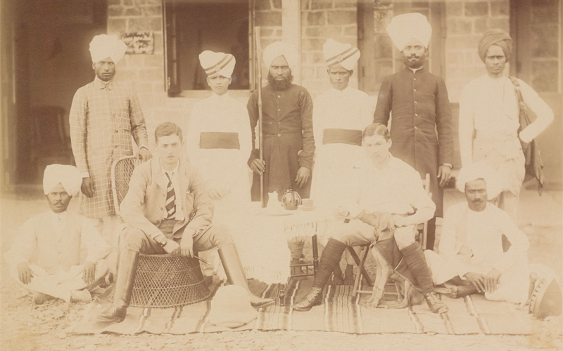 Charles Stooks (seated front left) with a colleague and their servants, Chakrata, 1898