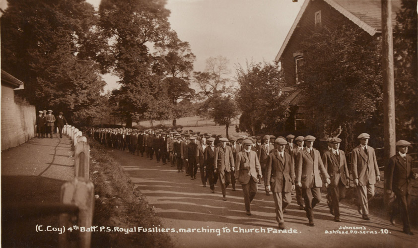 C Coy, 4th Public Schools Bn Royal Fusiliers in civilian dress marching to a church parade, Ashstead, 1914