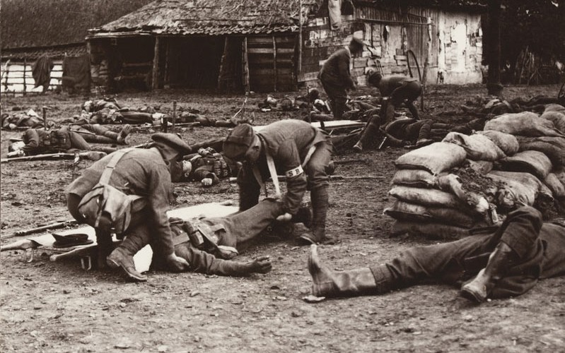 'Tenderly lifting a serious case. Stretcher bearers at work', c1915