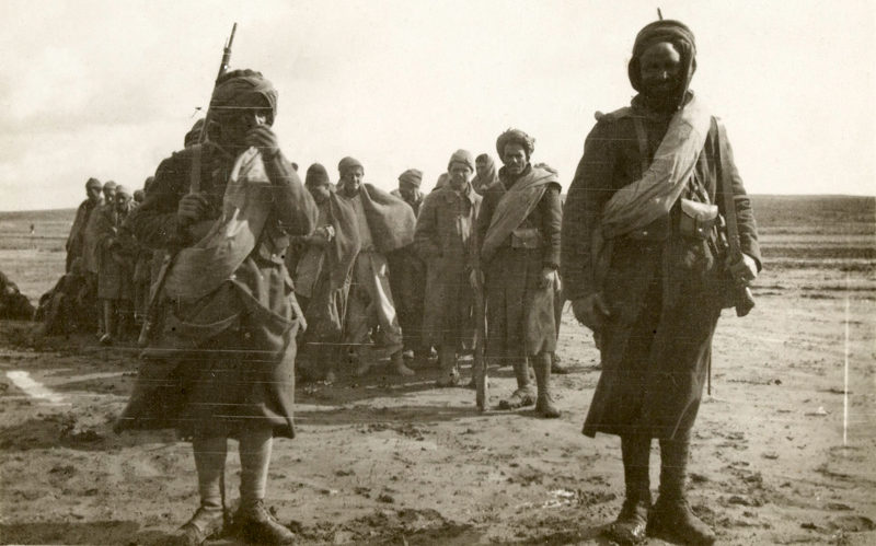 Joseph's photograph of Ottoman prisoners, being guarded by French Algerian soldiers, 1917