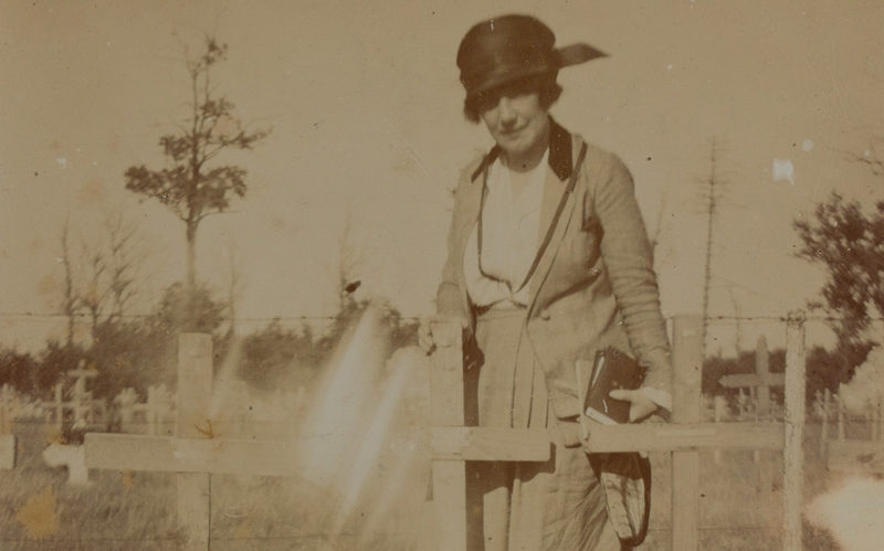 Helen McKie standing by the grave of her brother Douglas McKie, 1919