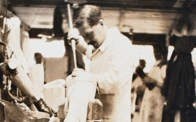 A worker constructing Cyril's prosthetic leg, 1918