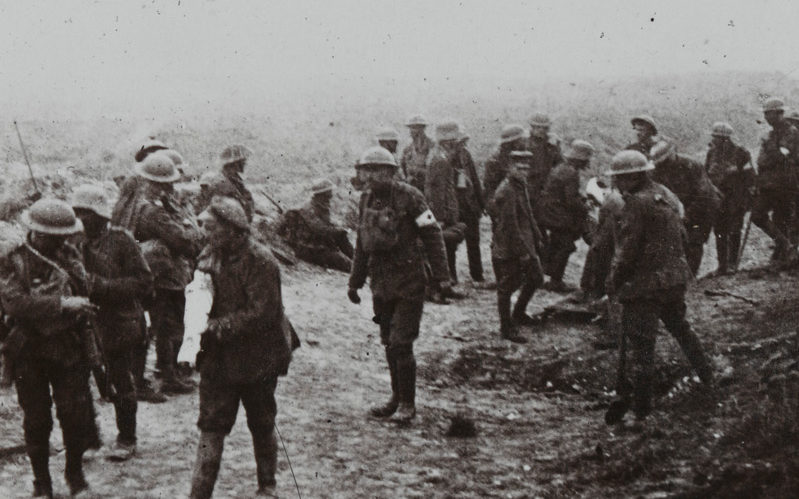 'Attending to wounded on the Menin Road, Ypres, during the stiff fighting around Zonnebeke', 1917