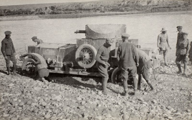 Digging out a Dunsterforce armoured car after a river crossing, 1918