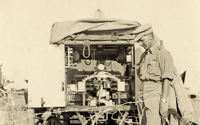 Captain William Leith-Ross next to a wireless wagon station, c1916