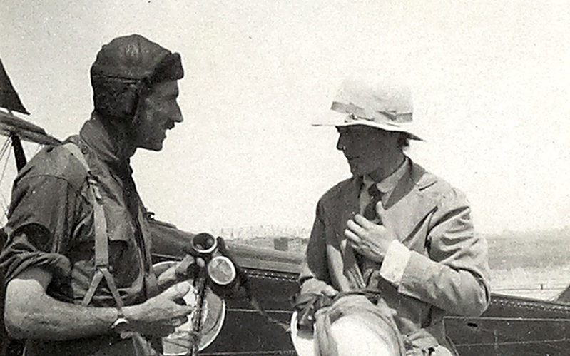 Leith-Ross talking to a visiting dignitary shortly after landing his aircraft, Mesopotamia, April 1919