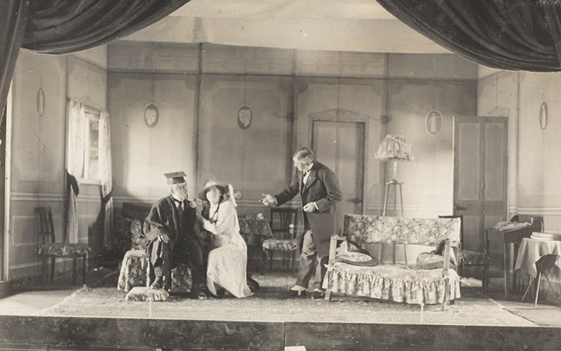 'Private SH Swann as 'Dr Candy' sits with 'Nancy Roach', aka Lieutenant CE Hastie in 'The New Boy', 1918