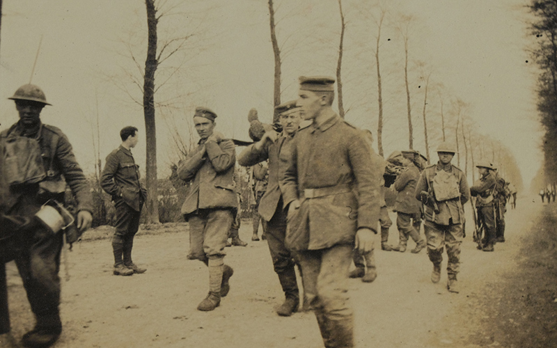 German prisoners bringing in wounded men from the Worcestershire Regiment after their attack on La Crêche, April 1918