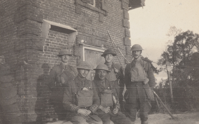 Lieutenant-Colonel Bowcher Clarke with staff from his battalion headquarters near the Forest of Nieppe, April 1918. His caption notes they were 'being constantly shelled by high explosives and gas.'